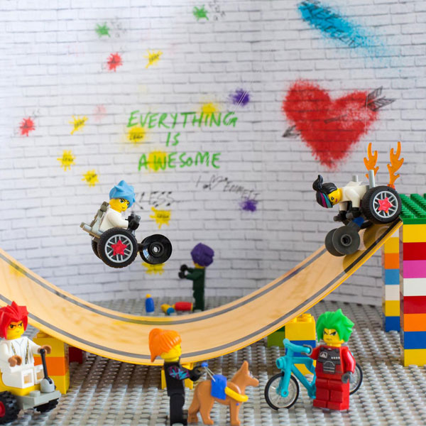 #ToyLikeMe makeover image showing Lego wheelchair skate park featuring mini-figures with wheelchairs.