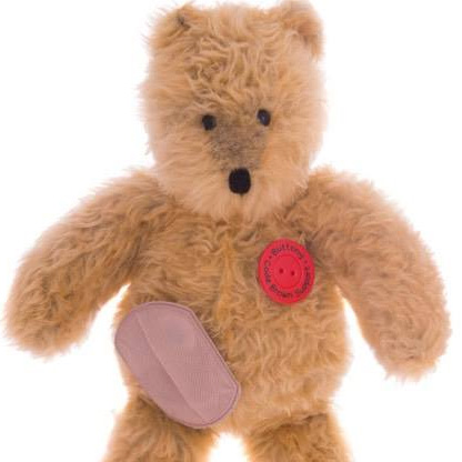 Image shows plush bear with ostomy pouch and stoma.