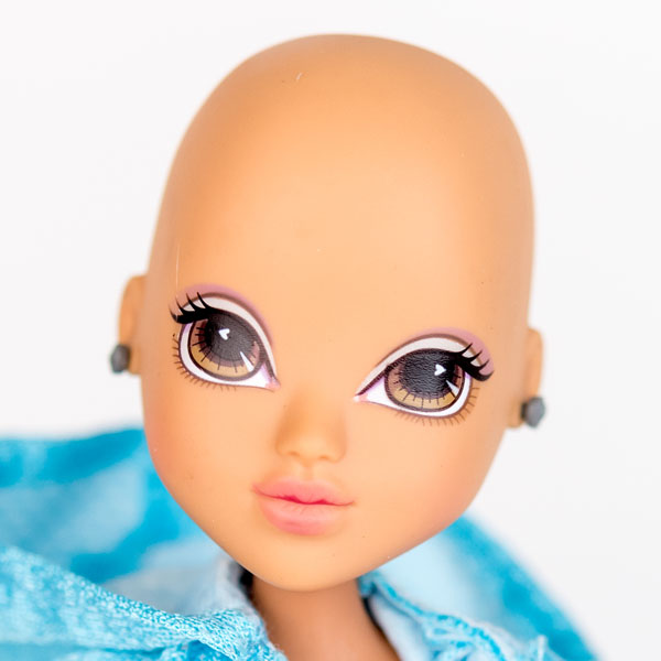 Close up of Moxie doll with no hair, smooth head and earrings.