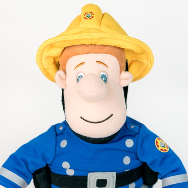 Plush Fireman Sam doll with blue jacket and yellow fire fighter