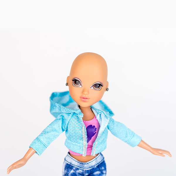 Moxie doll with no hair, smooth head, blue hoodie, pink t-shirt and stud earrings.