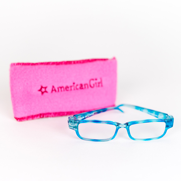 American Girls glasses in blue, and pink glasses case in background.