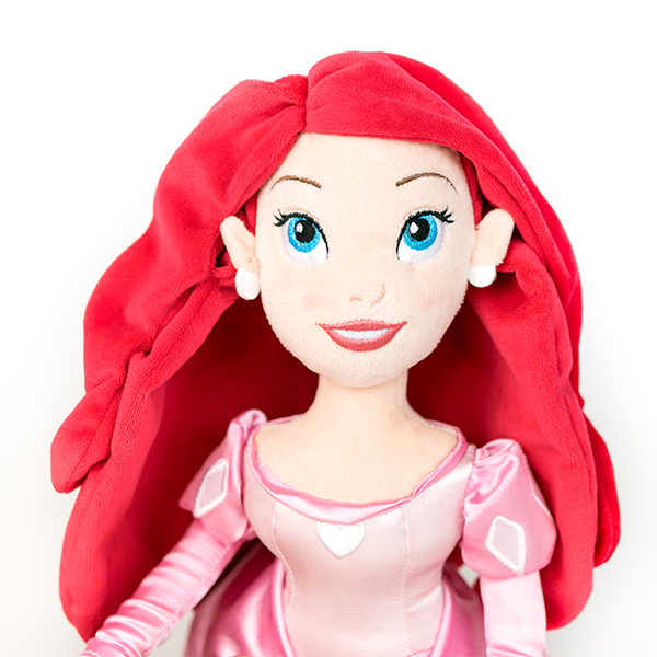 Plush Disney Ariel doll with pink dress and red hair.