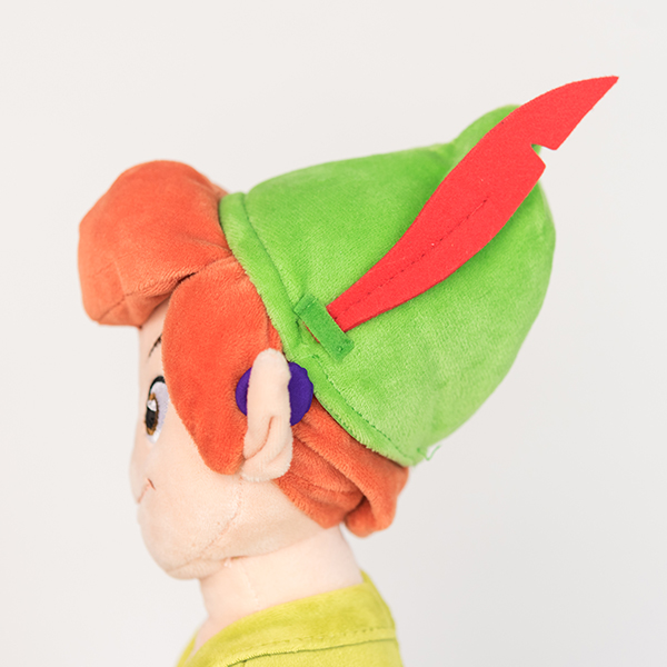 Plush Disney Peter Pan doll with purple 3D printed hearing aid.
