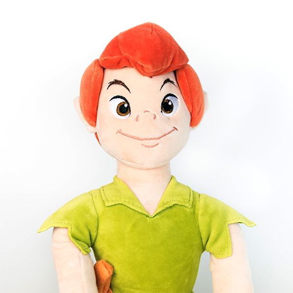 Plush Disney Peter Pan doll with green top and orange hair.
