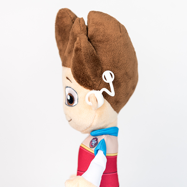 Plush Ryder from Paw Patrol toy with white 3D printed cochlear implant.