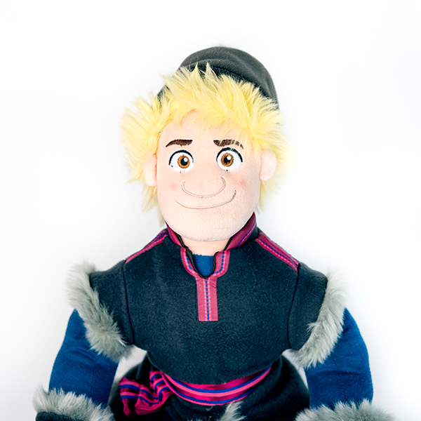 Plush Disney Frozen Kristoff doll with blonde hair, hat and fur trimmed coat.