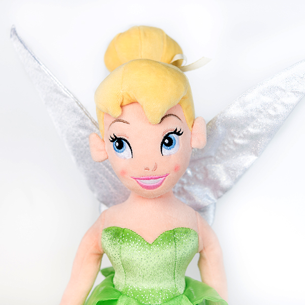 Plush Disney Tinkerbell doll with green dress and white wings.