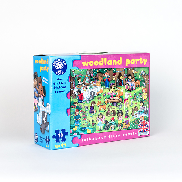 Image shows the box of a Woodland Party Jigsaw. The image on the box shows characters and animals having a party. There is a girl using a pink wheelchair in the image.