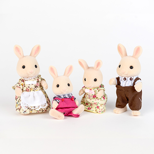 Image shows a family (parents and two children) of cream rabbit figures. All are wearing clothing.