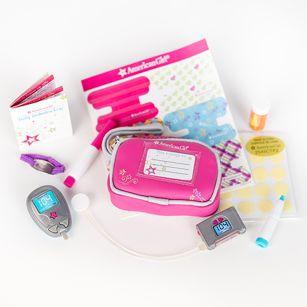 Image shows items from a toy diabetes care kit including pouch, stickers, pen, monitor, log book.