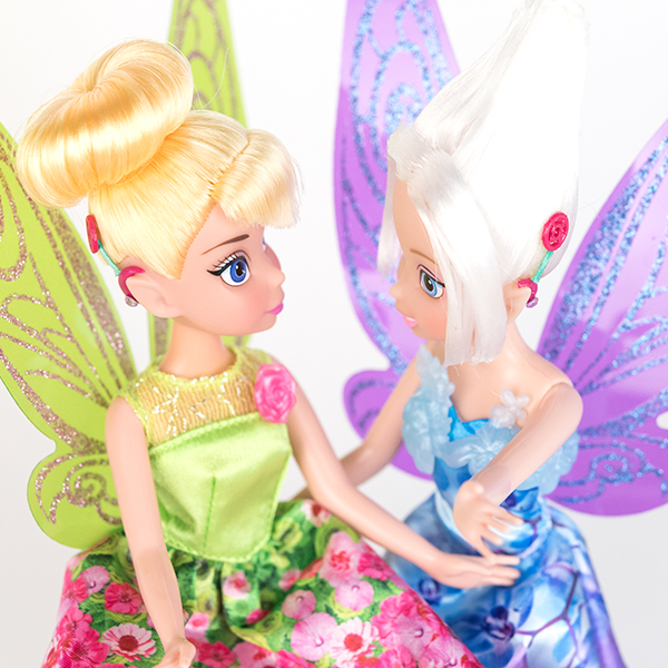 #ToyLikeMe makeover image showing Disney Tinkerbell and Periwinkle dolls with hot pink model cochlear implants.